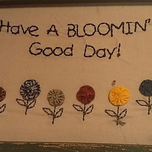 Embroidered 'have a blooming good day' wall decor